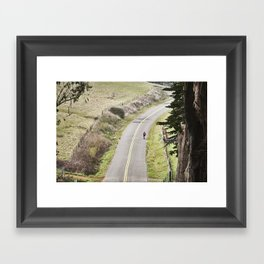 The lonely cyclist Framed Art Print