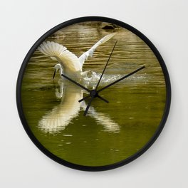 The heron lays on the placid river... Wall Clock