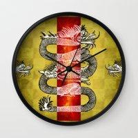 mandie manzano Wall Clocks featuring The Dragon by Diogo Verissimo