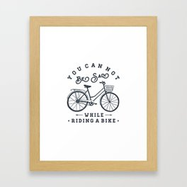 You can not be sad while riding a bike Framed Art Print