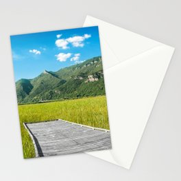 Beautiful mountain scenic with wooden footpath in field under sunlight Stationery Cards