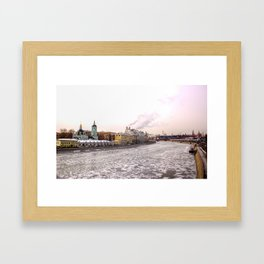 A view of spring ice floes on the Moscow river with Kremlin Framed Art Print