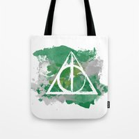 deathly hallows Tote Bags featuring The Deathly Hallows (Slytherin) by FictionTea