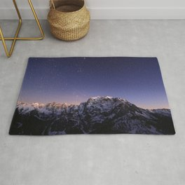 Starry sky above mountains Rug