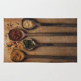 Spoons filled with spices Rug