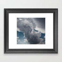 Clouds in the blue sky Framed Art Print