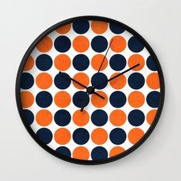 navy and orange dots Wall Clock