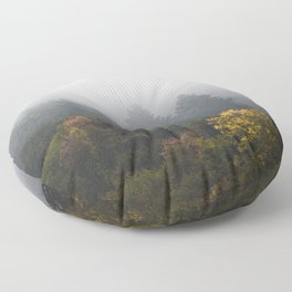 Autumn forest wrapped in fog Floor Pillow