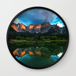 Burning sunset over the mountains at lake Fusine, Italy Wall Clock