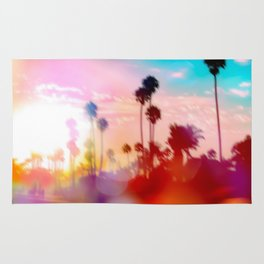 palm tree with sunset sky and light bokeh abstract background Rug
