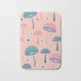 Dancing mushrooms in pink Bath Mat