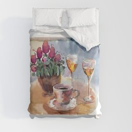 Romantic meeting. Round table of a street cafe with a cup of coffee, liqueur and flowers in a pot  Comforters