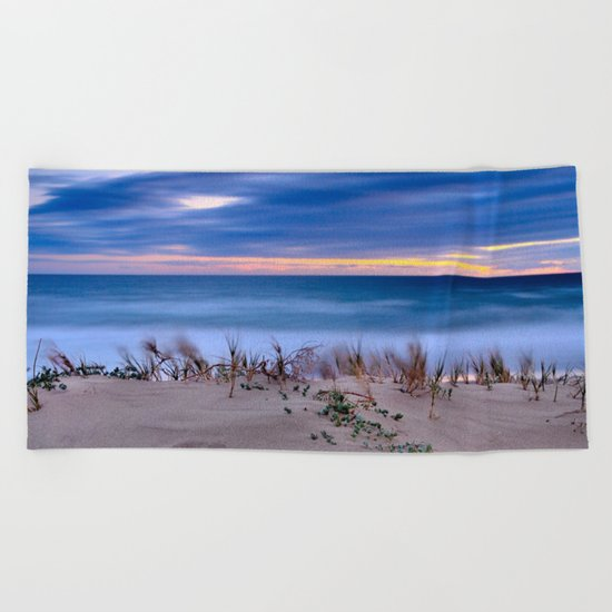 Windy sunset at the beach Beach Towel