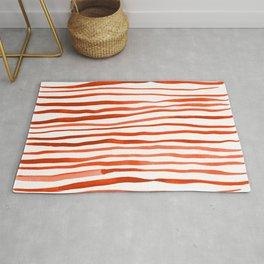 Irregular watercolor lines - orange Rug