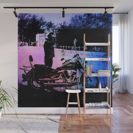 Biker with his motorcycle in a surreal landscape Wall Mural