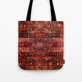 Egyptian hieroglyphs gold on red painted texture Tote Bag