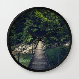 Simple suspension bridge over river Idrijca, Slovenia Wall Clock