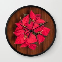 Red Christmas flower on brown wood Wall Clock