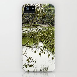 Tree Branches Hanging over the Emerald Green Colored Hoan Kiem Lake in Hanoi, Vietnam iPhone Case