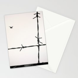 Freedom, a seagull is flying totally free beyond a spiked wire. Stationery Cards