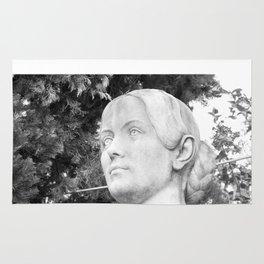 female statue Rug