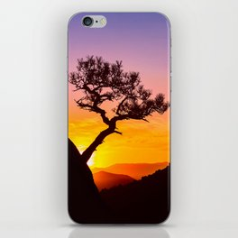 Sunrise in mountains with tree and sea iPhone Skin