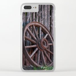 Old Wagon Wheel leaning up against a stick fence Clear iPhone Case