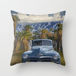 Vintage Blue Plymouth Automobile against Palm Trees and Cloudy Blue Sky near Palm Springs California Throw Pillow