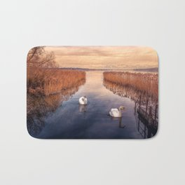Two Beautiful Elegant White Swan Swimming Along River Between Reeds Ultra HD Bath Mat