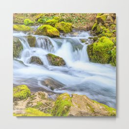 A small stream with a waterfall and mossy rocks in spring Metal Print