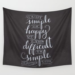it is very simple to be happy, but it is very difficult to be simple Wall Tapestry
