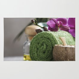 Spa Concept. Beautiful Spa Products on concrete background Rug
