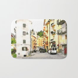 Road between buildings with cars Bath Mat