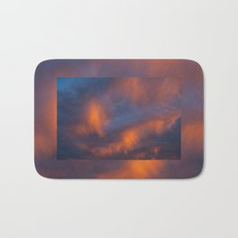 orange light on cirrus clouds and blue sky Bath Mat