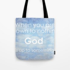 God is up to something Tote Bag