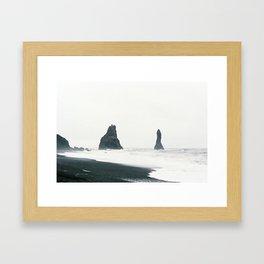Black sand view Framed Art Print