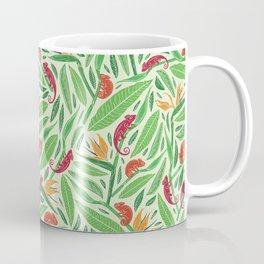 Red chameleon on strelitza amoung green palm leaves Coffee Mug