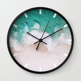 Waves spread out on the coast Wall Clock