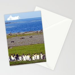 King Penguins on the beach with an Iceberg behind Stationery Cards