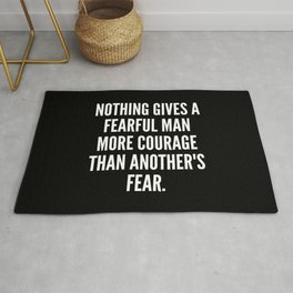 Nothing gives a fearful man more courage than another s fear Rug