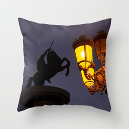 Skopje statue and streetlights at night Throw Pillow