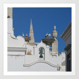 storks build nests on the church in the old town of faro, portugal, europe Art Print