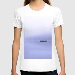 cottage blue, swimming dock rests on the still blue water, fog blankets the landscape T-shirt