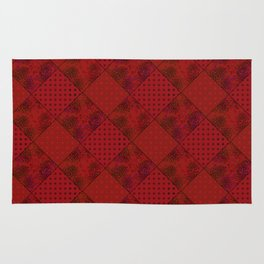 Patchwork shades of red Rug