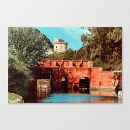 Ponte Rosso: a bridge over a canal running to the sea Canvas Print
