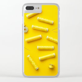 Colorful yellow thread spools over bright yellow background Clear iPhone Case