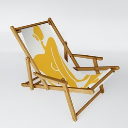 Sitting nude in yellow Sling Chair