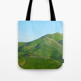 green field and green mountain with blue sky Tote Bag