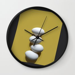 Eggs on yellow sheet Wall Clock