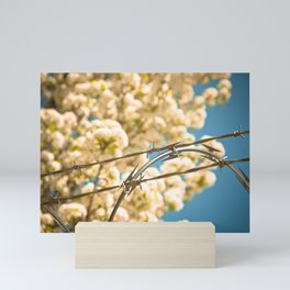 Wires and blossoms Mini Art Print